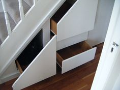 Ferocious White Painted Plexwood Pull Out Drawers As Storage Under Stairs With Fake Wooden Floors In Basement Furniture Decors Ideas