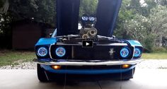 Rocking a sexy Grabber Blue and Black paint scheme, custom interior and blown 351 Cleveland this is a very well executed 1969 Mustang build. See the video!