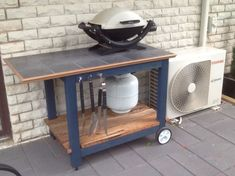 My bbq trolley, the bottom shelf is timber from the old fence Table Top Bbq, Grill Table, Grill Stand, Grill Cart, Barbecue Design, Grill Design, Bbq Shelter Ideas, Diy Pallet Projects, Outdoor Projects