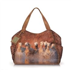 This shoulder bag features a Jim Zuckerman print of Charging Horses and a whip stitch detail. Includes a dividing interior zip pocket, two open slip pockets, one zip pocket, and two exterior side pockets.