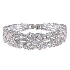 Expertly appointed with three shimmering cubic zirconia and an antique floral pattern, this vintage bangle bracelet adds a touch of traditional glamour to any look. The bracelet is finished with rhodium-plated glass in a high gloss for added appeal. Bridal Bangles, Flower Bracelet, Schmuck Design, Silver Pearls, Vintage Flowers, Bridal Accessories, Jewelry Design, Jewelry Ideas, Jewelry Box
