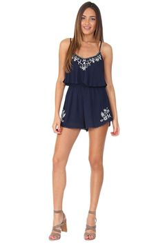 Navy blue layered romper featuring adjustable straps, embroidered print around bust and bottoms, synched waist, and embroidered lower hem. Perfect for any daytime occasion! Pair with silver bangles and nude wedges or sandals.