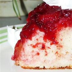 12 crushed strawberries on bottom of 13x9. Sprinkle strawberry jello on top. Cover with 3 cups mini marshmallows and prepared yellow cake mix. Bake 350 40-50 mins. Turn upside down  on cookie sheet. YUMMMMM!