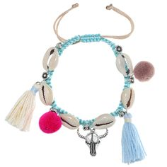 Bull bracelet, with shells and tiny balls and tassels. www.yehwang.com
