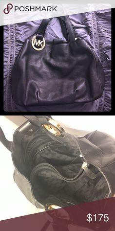 Authentic Michael Kors Black Leather Purse Authentic 2 strap Michael Kors leather bag with gold medallions on straps. 3 inside compartments, middle zips up. Magnet closure. Michael Kors Bags Shoulder Bags