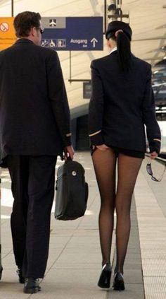 Sexy stewardess in black nylons