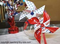 4th of July Pinwheels. Here are a few toddler party ideas for decorations. We were unable to find gift wrap so we used gift bags found at the Dollar Tree which worked out fine. The paper was a little thicker and glossy which made these projects have a nice finished look.     This is a purely decorative pinwheel to dress up a party table. Making one that works, requires using pins and dowels which I felt were best for older children.