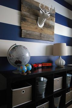 Blue stripes for boys room.  Cabinet for storage.  The Shabby Nest: My Boys' Room: The Reveal~