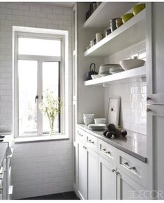 We've always loved open shelves and this kitchen has perfect ones for a small space. From Elle Decor.