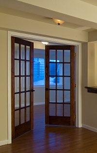 Really want to replace the sliding glass doors in the Breezeway to dark wood French doors like this.
