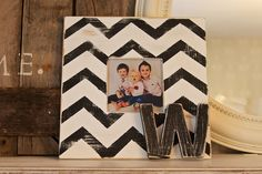 Super cute and easy to do.  They sell frames like this at crafts stores for $1...doing this!