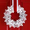 Glittery Snowflake Wreath--grab the ribbon and snowflake ornaments from Dollar Tree and this high-end look for less!