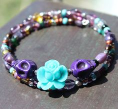 Day of the Dead Sugar Skull Bracelet by VivaGailBeads Skull Bracelet, Day Of The Dead, Sugar Skull, Dark Side, Skulls, Buy And Sell, Turquoise, Beads, Purple