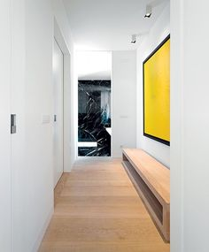 The clean tones of the hallway. Timber colour