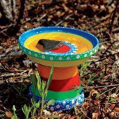 pot and saucer bird bath--just remember to bring them in the house at the end of the season; the clay will rot/fracture thru winter/cold months.