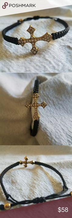 "CROSS BRACELET NEW (never worn), beautiful crystal stone cross bracelet,  set in brass. Looks like real diamonds. Adjustable ""slide"" bracelet (black).  Cross is approx .75 inches long.  Great gift for a fav gal pal or yourself! Lisa Lebow Jewelry Bracelets"