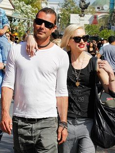 ARM-Y STRONG Gwen Stefani has her hands full with her bag of loot and, of course, husband Gavin Rossdale on a Saturday shopping trip at The Grove in L.A.