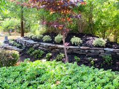 DIY Stacked Stone Retaining Wall – Part 2 – DustandDoghair Dry Stack Stone, Stacked Stone Walls, Diy Pallet Vertical Garden, Paver Sand, Wall Trellis, Stone Retaining Wall, Different Plants, Green Lawn, Garden Beds