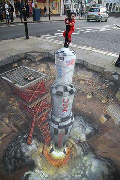 3D street art using chalk by Julian Beever.