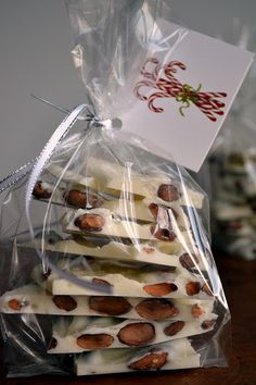 White Toasted Almond Bark with Sea Salt. tagged and wrapped for gifting. This is delicious, and I made with almond bark instead of white chocolate. Edible Christmas Gifts, Neighbor Christmas Gifts, Edible Gifts, Neighbor Gifts, Best Christmas Gifts, Christmas Goodies, Christmas Candy, Christmas Treats, Holiday Treats