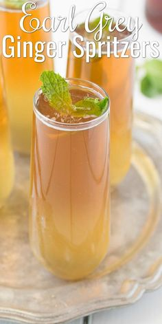 Earl Grey Ginger Spritzers are a refreshing mocktail or cocktail recipe Perfect for Spring and Summer Great for Easter Memorial Day or of July BBQ s from Culinary Ginger for Serena Bakes Simply From Scratch Cocktail Party Food, Cocktail Drinks, Fun Drinks, Cocktail Movie, Cocktail Sauce, Cocktail Attire, Cocktail Shaker, Beverages, Cocktail Dresses