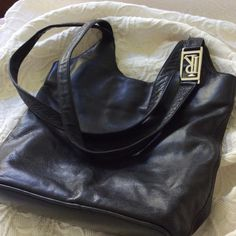 """Ralph Lauren handbag/crossbody Silky soft black leather RL purse, like new. Clean inside and out. Large silver RL on strap and one on side zipper, pix 2. Size 12"""" high, 12"""" wide and 4-1/2"""" thick. Without blemish. Ralph Lauren Bags Crossbody Bags"""