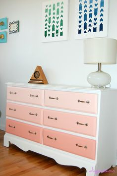 DIY Coral Ombre dresser...for the nursery.  My mom painted it and used chalk paint with a water based poly finish.  We did the bottom drawers the base paint color, 3/4 parts color to 1 part white for middle, and 1/2 color 1/2 white for top drawers.
