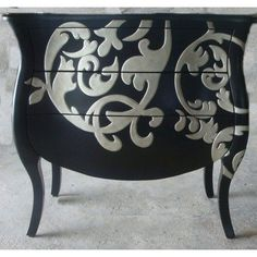 This is a Walmart dresser, but it gave me an idea. I suck at stencils, so I could recreate this by buying the large wall stickers and sticking it on a piece of furnature