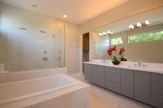 A bathtub and a two-headed shower allows for a luxurious bathroom retreat.