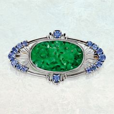 Platinum, jade and sapphire brooch, Tiffany & Co., Designed by Louis Comfort Tiffany, 1915–1930.