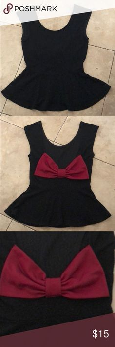 Muffin top with bow Super cute black muffin top with big red bow on low open back, has like leopard black print on the shirt all on it! ** My pre owned clothes will be washed before being shipped☺️** Poetry Tops