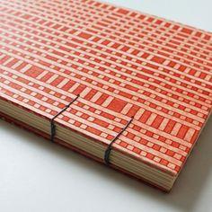 Beautiful paste paper journal ... rust. $12.00, via Etsy.
