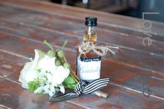 Groom's white buttonhole with a gift to calm the nerves... Henri & Madeline's wedding