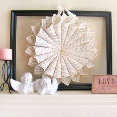 Simple Valentine's Day Mantel with Sheet Music Wreath   -too bad I don't have a mantle! :-)