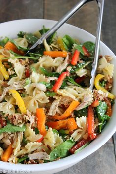 Oriental Chicken Pasta Salad ~ I have made this salad dozens of times! I have made it for friends coming over for dinner and served it with a side of garlic bread. I have made it for baby and bridal showers, you name it. It makes a ton and is pretty easy to make! Not only that, it's a gorgeous salad and has the best flavor.