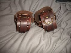 "new cuff designs, based on victorian asylum restraints  hand dyed ""steampunk"" brown leather and brass  £20.00 per pair"