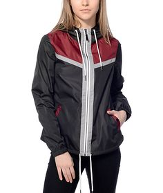 Layer any hoodie or top with this Adley black and burgundy windbreaker by Zine. This windbreaker has a unique bottom hem that runs long with rounded bottoms giving you a whole new look to your windbreaker collection.