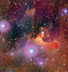 Clouds Roll By - ark nebula SH2 136 usually seems spooky when viewed in subdued colors, but here appears vibrant in a photo taken by the Canada-France-Hawaii Telescope.