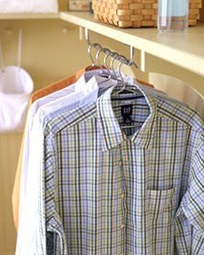 Mount a towel rack under the shelf in the laundry room to hang shirts while they dry.
