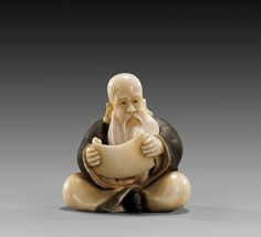 CARVED IVORY NETSUKE: Seated Man. Although I continue to thin out the ivory and purchase no more, I still have pieces inherited and collected in my collection. I have considered auctioning all ivory collectibles to donate proceeds to organizations that protect from poaching and ivory smuggling.