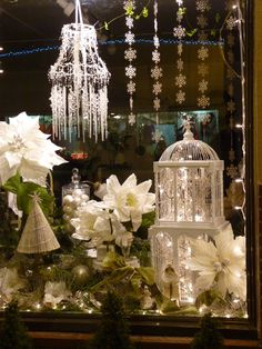 Shop window display at night, twinkling fairy light, birdcage and chandelier, lovely Anna www.melodymaison.co.uk