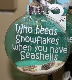 Something completely different from Happy Trails! A lovely glass disc ornament for the Christmas tree decorated with the phrase Who Needs Snowflakes when you have Seashells on a thin piece of acetate contained inside the glass ball. Also, inside the ball is beach sand and at least 5 mini seashells.
