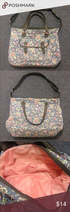 "Large Floral Purse - Like New! Large, like new Candie's purse with floral design. Only used once during a trip. Shorter double shoulder strap and longer, adjustable strap (2' at longest length). Large front pocket with double snap closure. Main compartment zips shut. Inside there are two slide pockets and one zippered pocket. Pink, clean lining. No rips, stains, or fading. Roughly 19""L x 7""W x 14.5""H. Candie's Bags"