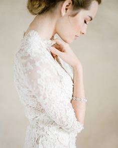 Another beauty from our editorial with @belairebridal with dreamy photography by @ktmerry. Photo: @ktmerry l Gown: @samuellecouture l Earrings and Bracelet: @belairebridal l Hair & Makeup: @teamhairandmakeup @teamextensions #bridalstyle #beautifulbride #bride by joyproctor