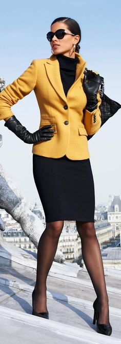 Black skirt & turtleneck w/bright yellow jacket