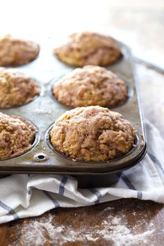 These Healthy Cinnamon Sugar Apple Muffins use whole wheat flour, coconut oil, and less sugar to make for a healthy, cozy fall treat!