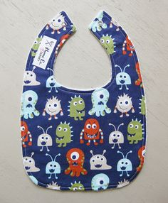 """Super cute funny monsters bib by the Home Ec Flunky! Knowing my husband this will start  him and our daughter on a """"grrrr""""-ing competition to see who can be the biggest monster!"""