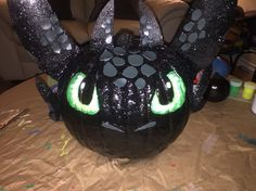 Toothless from How to Train your Dragon made into a decorated pumpkin. My son loved working on it with me
