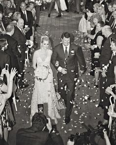 Amid the flutter of hundreds of rose petals, Joyann and Jeremy recessed down the aisle as newlyweds.