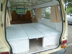 Fold out bed inside our vintage camper van